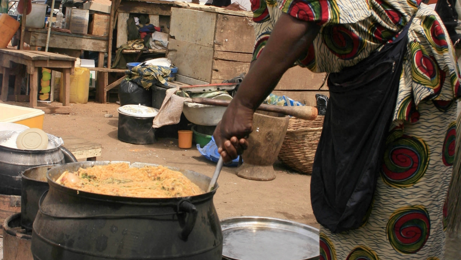 "A food vendor prepares ""jollof rice,"" a traditional meal usually made using chicken, in the northern city of Kano."