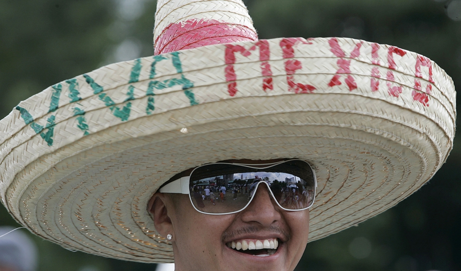 A man wears a sombrero as he listens to Latin music in celebration of Cinco de Mayo in Atlanta, Georgia.