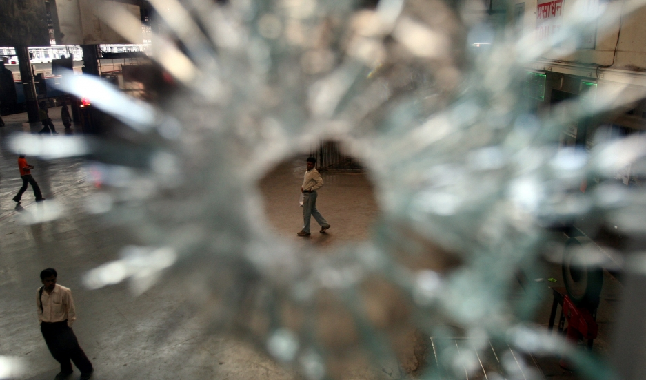Restaurant window damaged in 2008's militant attack is seen at the railway station in Mumbai.