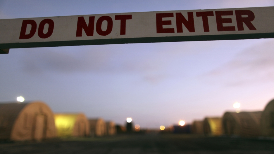 In this photo, reviewed by the U.S. Military, a sign marks a closed-off area, at Camp Justice, the location of the U.S. Military Commissions court for war crimes, at the U.S. Naval Base, in Guantanamo Bay, Cuba, January 19, 2009.