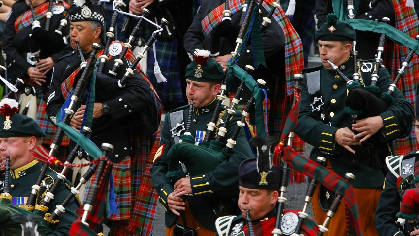 Pipers from the Edinburgh Military Tattoo Massed Pipes and Drums perform during the Edinburgh Fringe Festival parade in Holyrood Park in Edinburgh, Scotland.