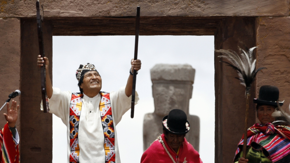 After being elected for a second term, Bolivian re-elect President Evo Morales, accompanied by indigenous leaders, holds the staff of command during an Aymara indigenous ceremony at the ancient Kalasasaya Palace at Tiwanaku, January 21, 2010. The Kalasasa