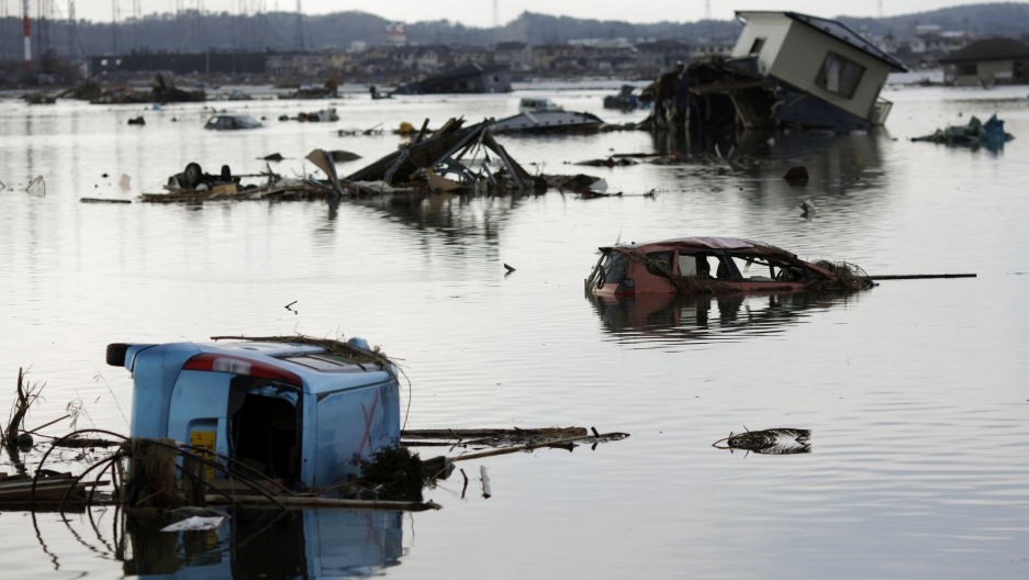 A house and vehicles damaged by the March 2011 earthquake and tsunami, as seen in Ishinomaki, northern Japan.