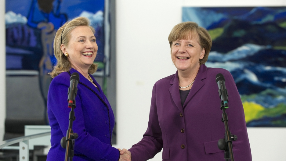 German Chancellor Angela Merkel shakes hands with US Secretary of State Hillary Clinton (L) prior to a meeting at the Chancellery in Berlin April 14, 2011.