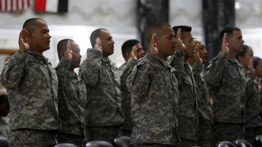 Servicemen from the US military take an oath during a naturalization ceremony at the Al-Faw Palace in Baghdad's Camp Victory on July 4, 2011.