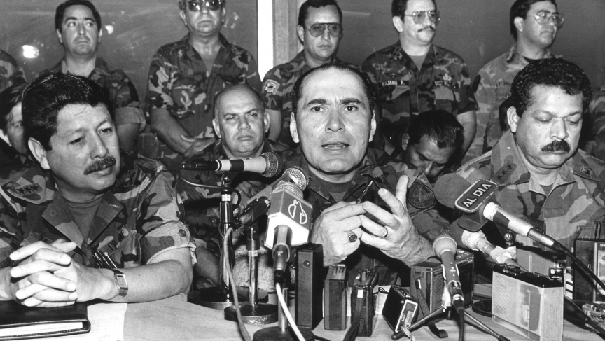 El Salvador's defense minister, General Rafael Humberto Larios, speaks during a news conference in San Salvador in a 1990 file photo. Larios and eight other former Salvadoran soldiers were arrested in 2011 for suspected involvement in the 1989 killing of
