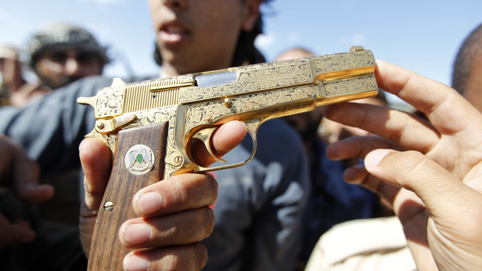 The gold plated pistol soon after it was seized by anti-Gadaffi rebels near Sirte