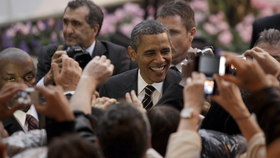 U.S. President Barack Obama greets an adoring crowd in Cannes, France on November 4, 2011.