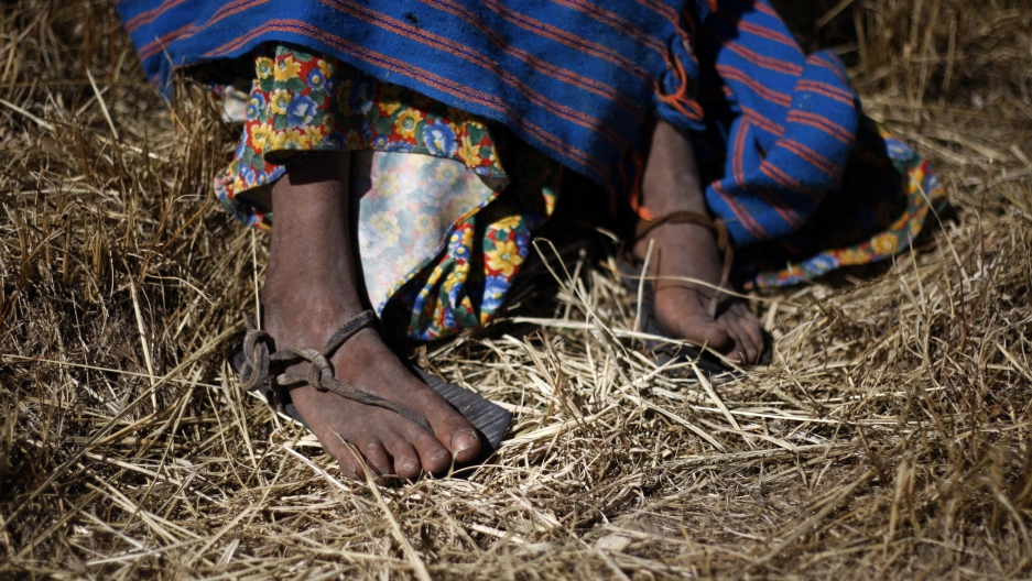 The feet of a Tarahumara girl are seen in Guachochi November 30, 2011.