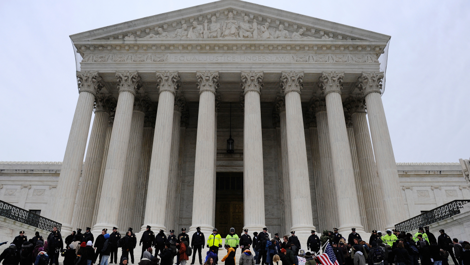 Demonstrators on the steps of the U.S. Supreme Court building, on the anniversary of the Citizens United decision, in Washington, January 20, 2012.