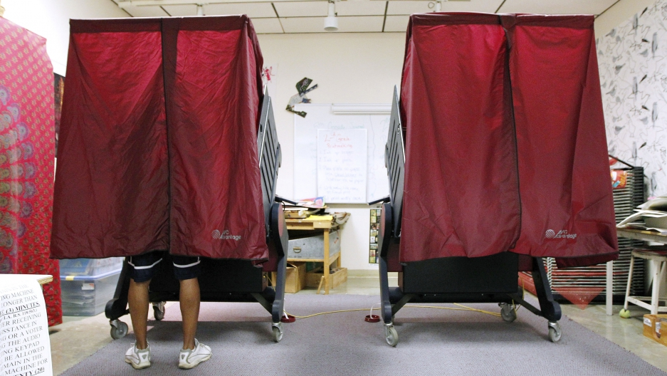 Two voting booths, red curtains drawn