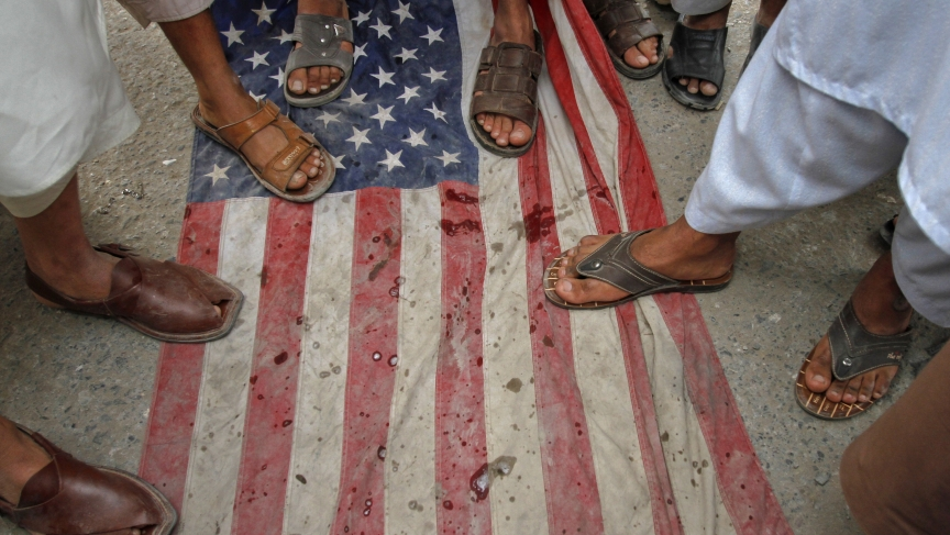 Men step on a U.S flag during an anti-American rally in Peshawar, Pakistan in April of last year.