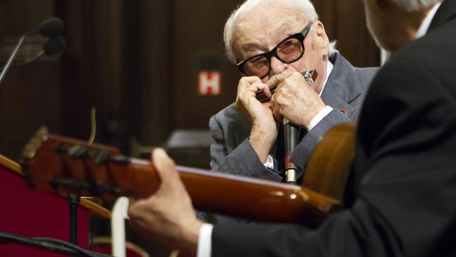 Belgian musician Toots Thielemans plays harmonica during a ceremony for his 90th birthday at Brussels' City Hall April 29, 2012. Thielemans was made honorary citizen of Brussels.