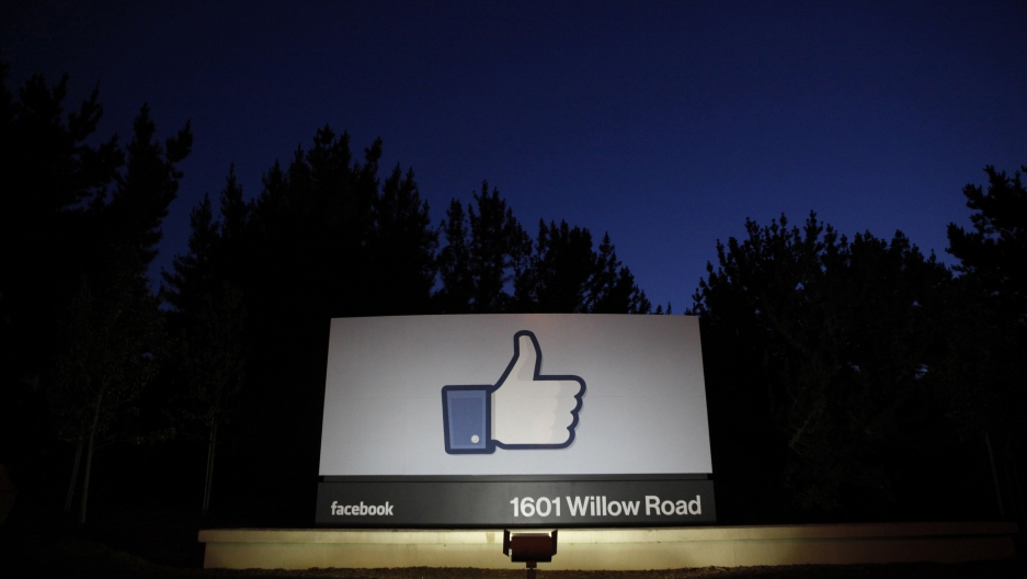 The sun rises behind the entrance sign to Facebook headquarters in Menlo Park before the company's IPO launch, May 18, 2012. Facebook Inc, will begin trading on the Nasdaq market on Friday, with it's initial public offering at $38 per share, valuing the w