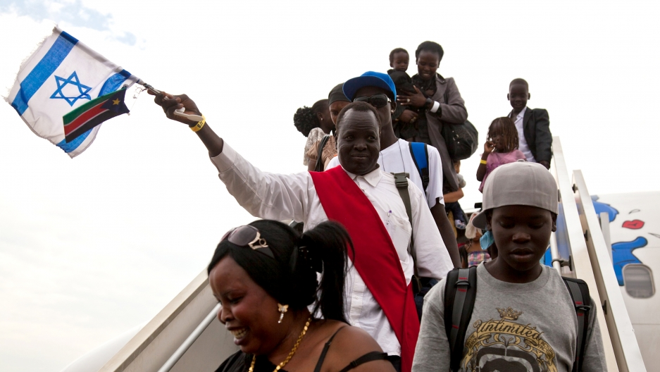 South Sudanese disembark from a plane from Israel after getting deported back to Juba, June 18, 2012.