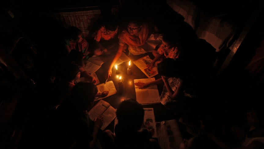 A teacher in Kolkata conducts a lesson during a particularly bad power outage that swept across India in July, 2012.