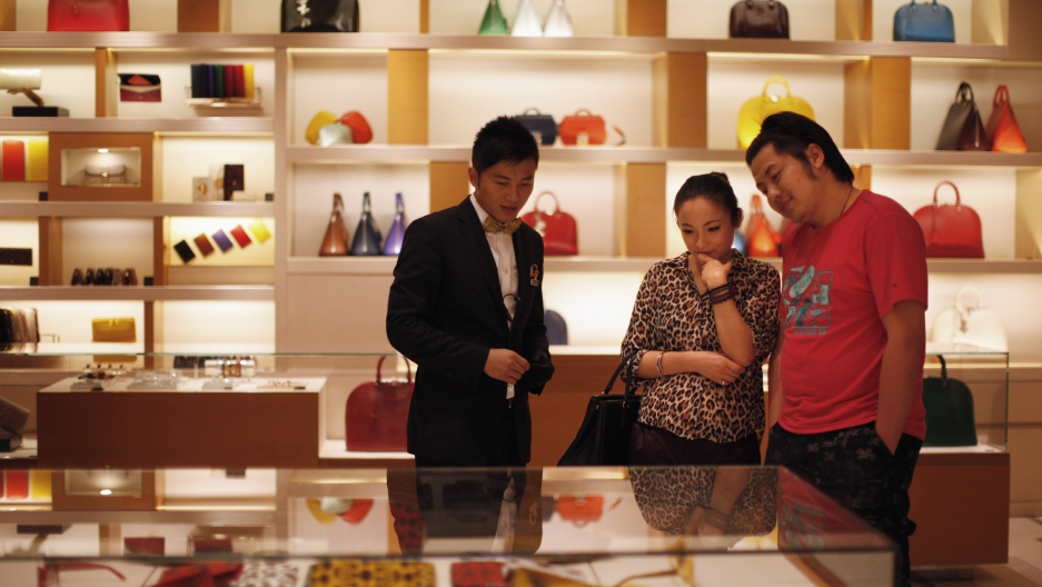 A couple shops at a Louis Vuitton store in China.