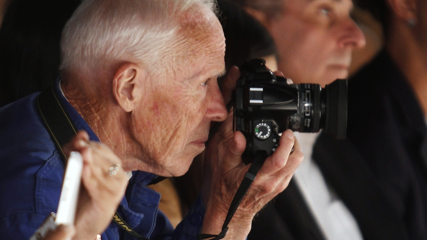 Bill Cunningham takes photos during the Naeem Khan Spring/Summer 2013 collection show at New York Fashion Week in 2012.