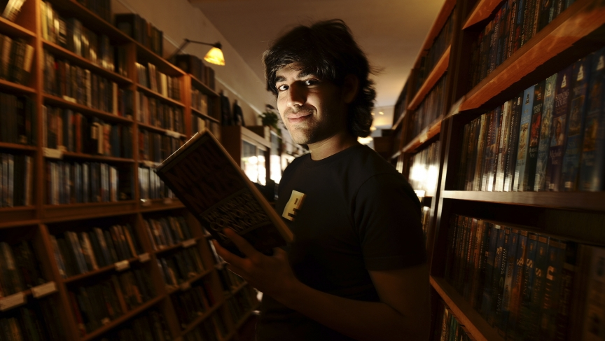 Aaron Swartz poses in a Borderland Books in San Francisco. The Internet activist is the subject of new documentary about his life, activism and death.