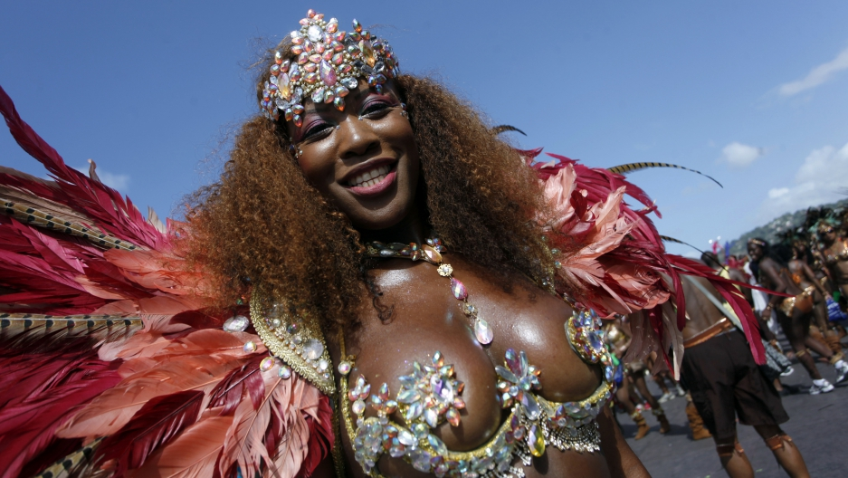 A masquerader during 2013 Carnival in Port of Spain, Trinidad and Tobago. This year, a Japanese tourist's murder spurred the mayor's resignation and a conversation about women's rights.