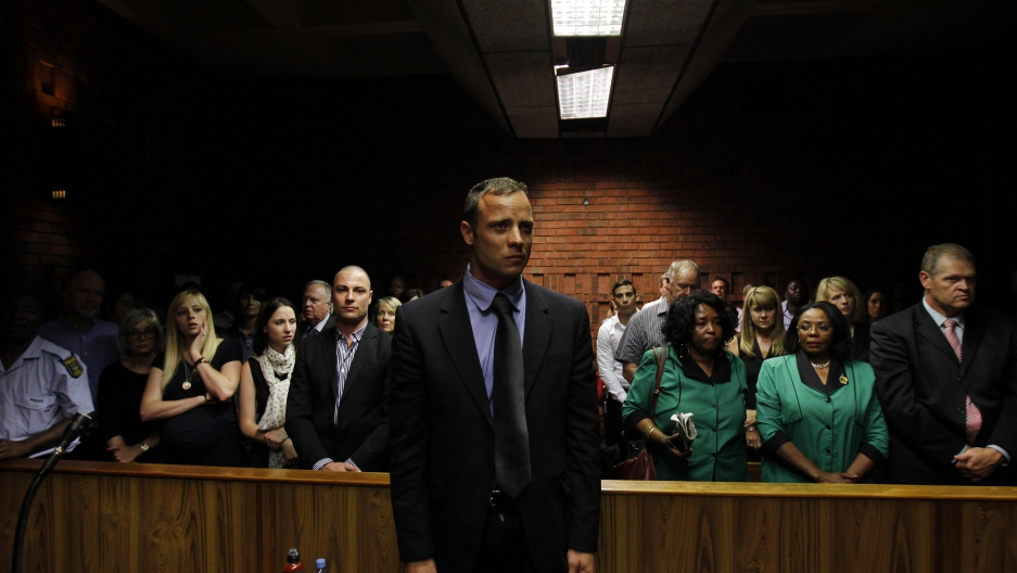 Oscar Pistorius awaits the start of court proceedings