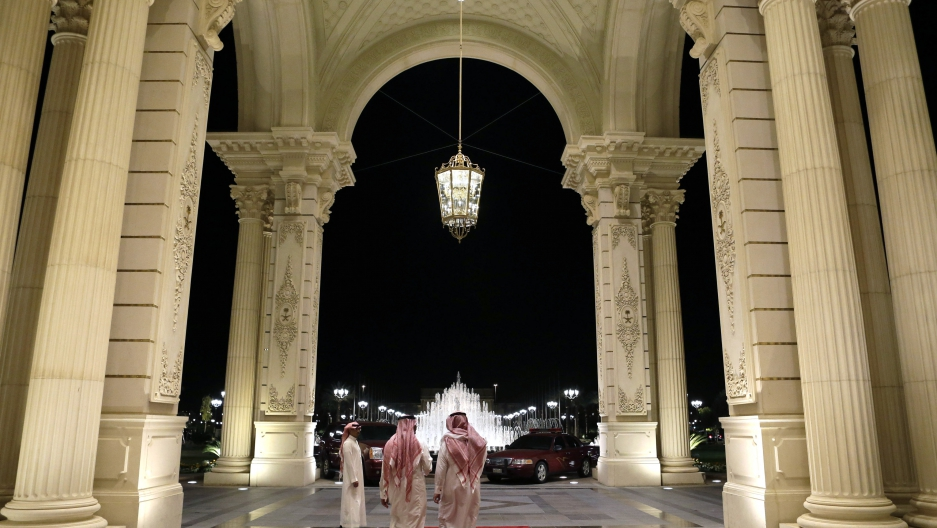 Saudi men walk at the entrance to the Ritz-Carlton Hotel, where U.S. Secretary of State John Kerry is staying in Riyadh March 4, 2013.