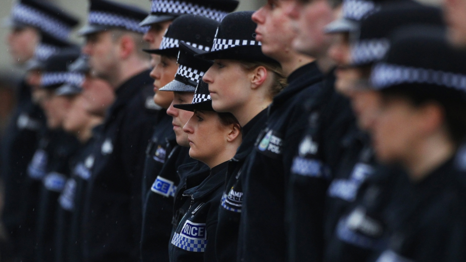 Police recruits stand to attention during their passing out parade at the Scottish Police College in Tulliallan, Scotland March 8, 2013.