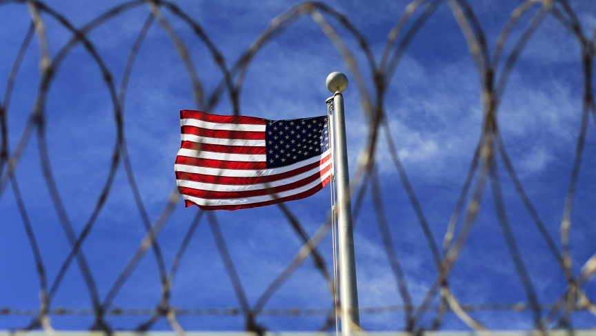 The U.S. flag flies over a prison used to house detainees at the U.S. Naval Base at Guantanamo Bay. The facility now holds around 150 prisoners who have been captured in Afghanistan and elsewhere since the September 11, 2001 attacks.