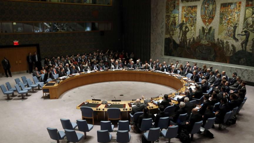 Members of the United Nations Security Council vote unanimously to approve a resolution on Syria's chemical arsenal on September 27, 2013.