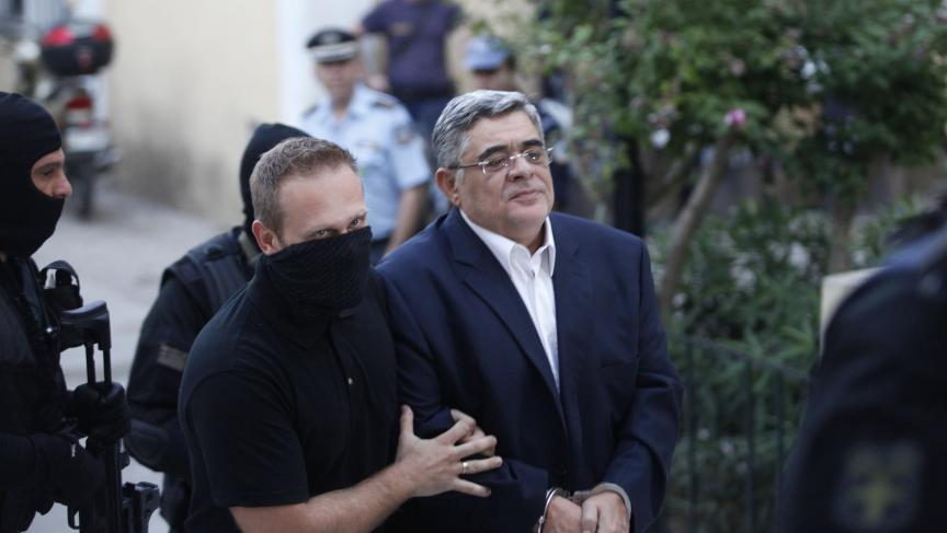 Far-right Golden Dawn party leader Nikos Mihaloliakos (R) is escorted by anti-terrorism police officers as he arrives at a courthouse in Athens September 28, 2013.
