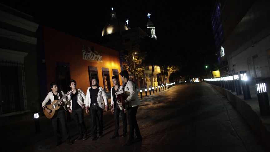 Members of a band record a narcocorrido in downtown Culiacan, Mexico.