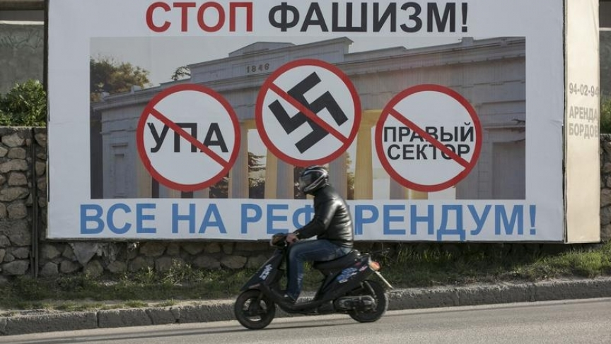 """A billboard urged people to vote in Crimea's referendum. The poster reads, """"Stop fascists everyone, come to the referendum"""" ."""