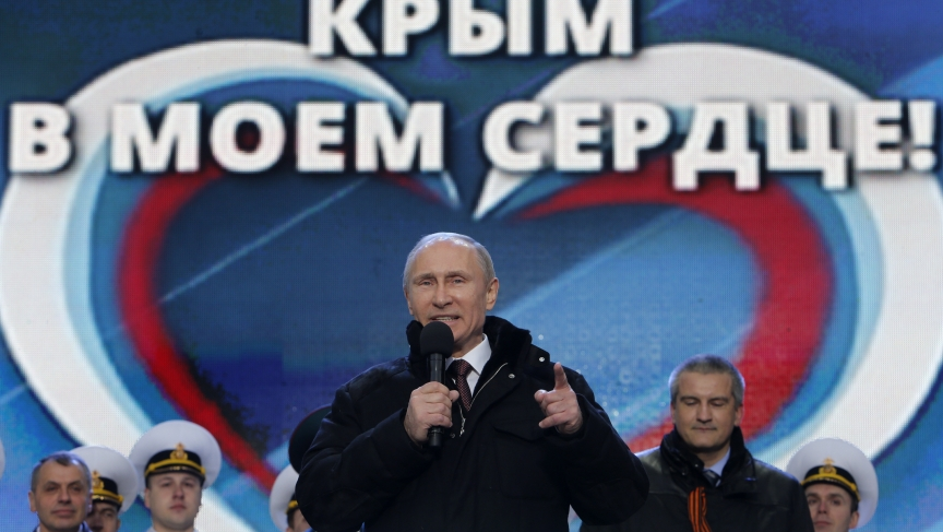 """Russia's President Vladimir Putin addresses the audience during a March 18th rally and a concert in Moscow called """"We are together"""" to support the annexation of Ukraine's Crimea to Russia. Defying Ukrainian protests and Western sanctions, Russia signed a"""