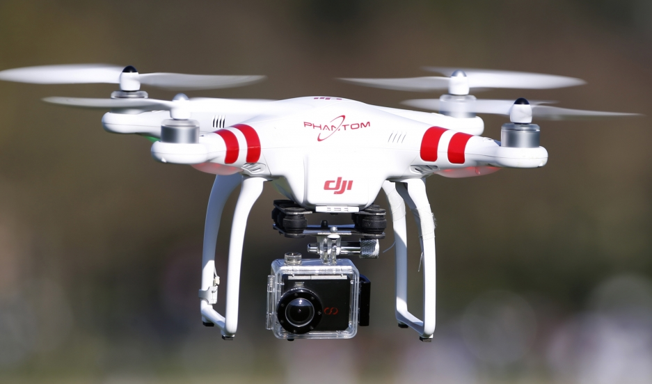 A Phantom drone by DJI flies during the 4th Intergalactic Meeting of Phantom's Pilots in western Paris in March 16, 2014.