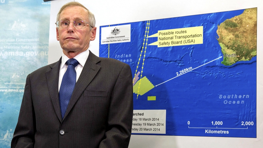 John Young, general manager of the emergency response division of the Australian Maritime Safety Authority (AMSA), stands in front of a diagram showing the search area for Malaysia Airlines Flight MH370 in the southern Indian Ocean, during a briefing in C