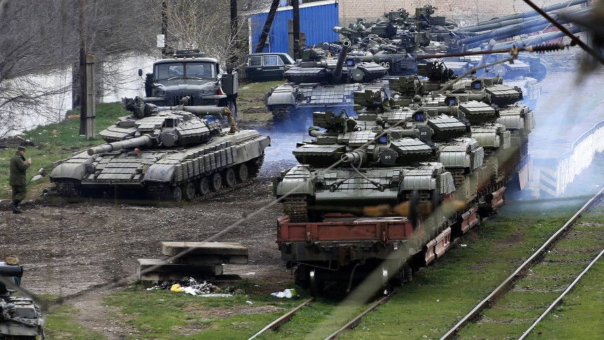 Russia has acquired control of considerable amounts of Ukrainian military equipment in Crimea. Here Russian soldiers are loading Ukrainian tanks onto a train in northern Crimea (Thursday).