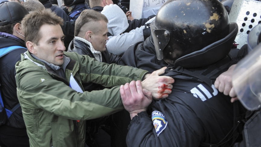 Pro-Russian activists scuffle with police near the regional government building in the eastern Ukrainian city of Donetsk. Protesters hung up a Russian flag in defiance of Kiev's pro-European government.