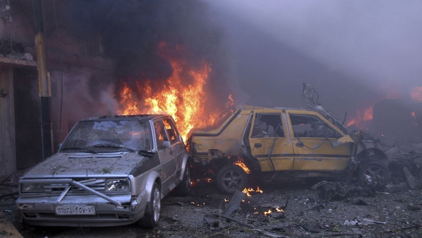 Vehicles burn after two car bombs exploded in the Karm al-Louz neighbourhood in Homs.
