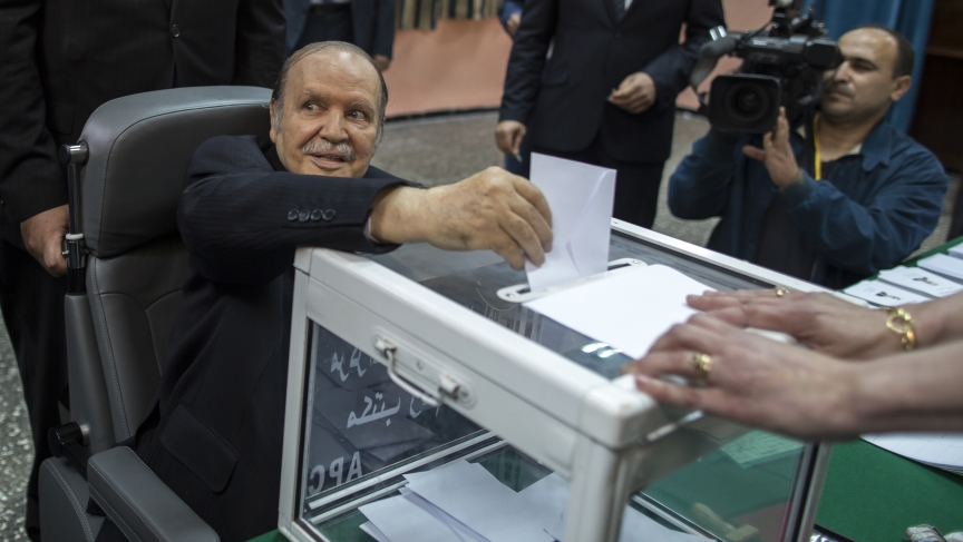 Algeria's President Abdelaziz Bouteflika casts his ballot during the presidential election in Algiers April 17, 2014. Algerians voted on Thursday in the election Bouteflika is expected to win after 15 years in power.