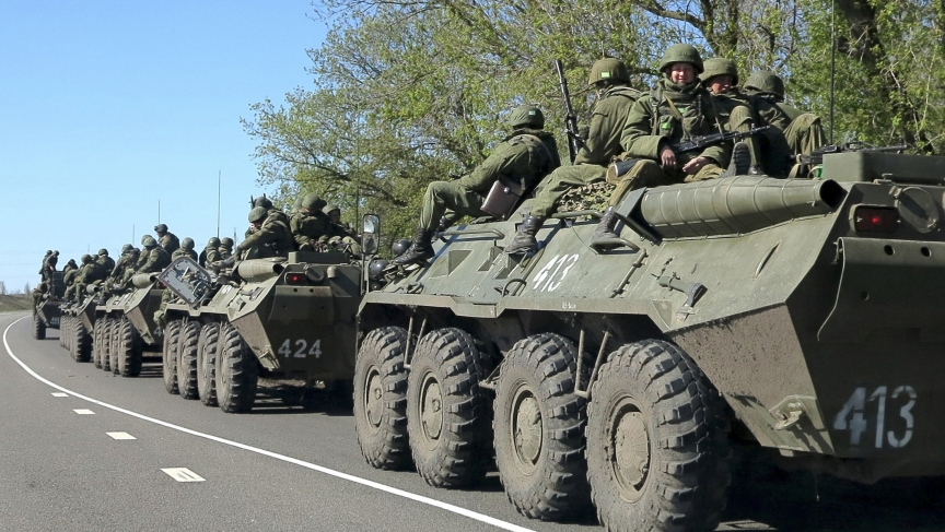 Russian troops on the move Friday, on the outskirts of the city of Belgorod, just a few miles from the border with Ukraine.