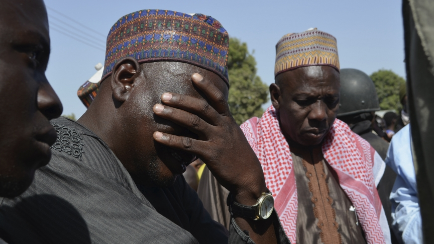 A man weeps with parents of kidnapped school girls abducted by Islamist militants.  Some 230 girls are still missing, a much higher figure than authorities originally said had been kidnapped.