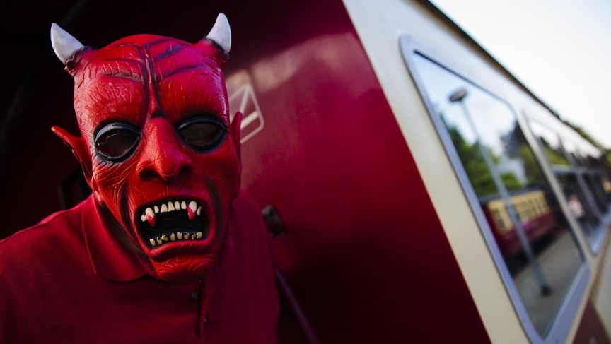 """A man with devil make-up takes part in celebrations marking the """"Walpurgisnacht"""" pagan tradition, in Germany."""