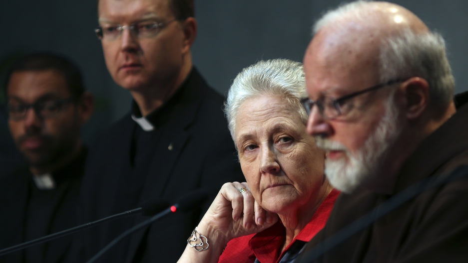 Marie Collins (2nd from right), who served as a memer of the Pontifical Commission for the Protection of Minors, watches as Cardinal Sean Patrick O'Malley (right) speaks during their briefing at the Holy See's press office at the Vatican in Rome on May 3,