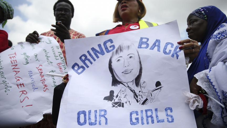 People take part in a protest demanding the release of abducted secondary school girls from the remote village of Chibok, Nigeria. The Islamist militant group Boko Haram claimed responsibility for the abduction of more than 200 schoolgirls