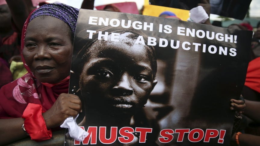 A woman holds a sign during a protest demanding the release of abducted school girls from the remote village of Chibok in northeast Nigeria.