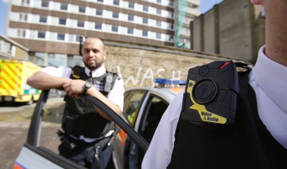 Two London police officers wearing a body-worn video cameras.