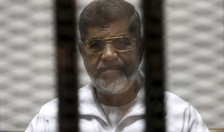 Ousted Egyptian President Mohammed Morsi during his trial at a Cairo court on May 8, 2014. He has been sentenced to 20 years in prison.