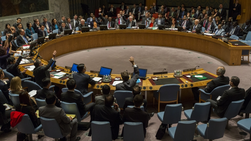 All members with the exception of Russia's UN Ambassador Vitaly Churkin and China's deputy U.N. Ambassador Wang Min vote in the United Nations Security Council in favor of referring the Syrian crisis to the International Criminal Court for investigation o