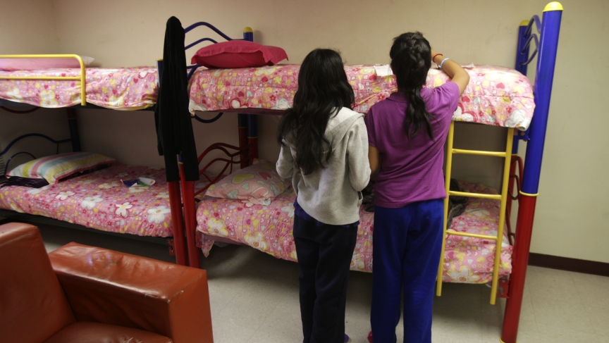 Girls stand in a dorm at the shelter for underage immigrants and repatriated minors in Ciudad Juarez, Mexico.