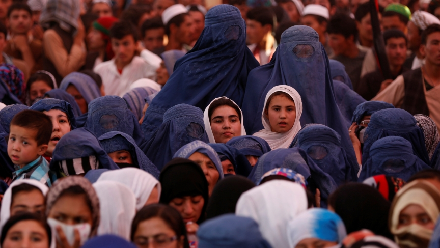 Women attend an election campaign by Afghan presidential candidate Ashraf Ghani Ahmadzai in Jozjan province on June 2, 2014. The second round of Afghanistan's presidential election will take place on June 14.